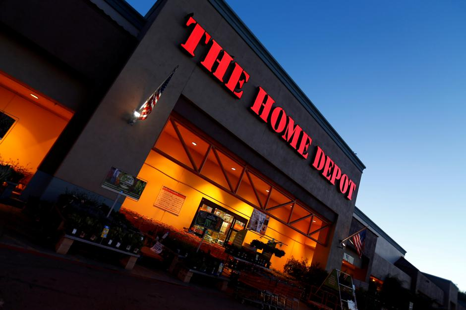FILE PHOTO: The logo of Down Jones Industrial Average stock market index listed company Home Depot is seen in Encinitas, California
